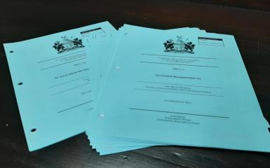 An image of blue papers used for printing bills